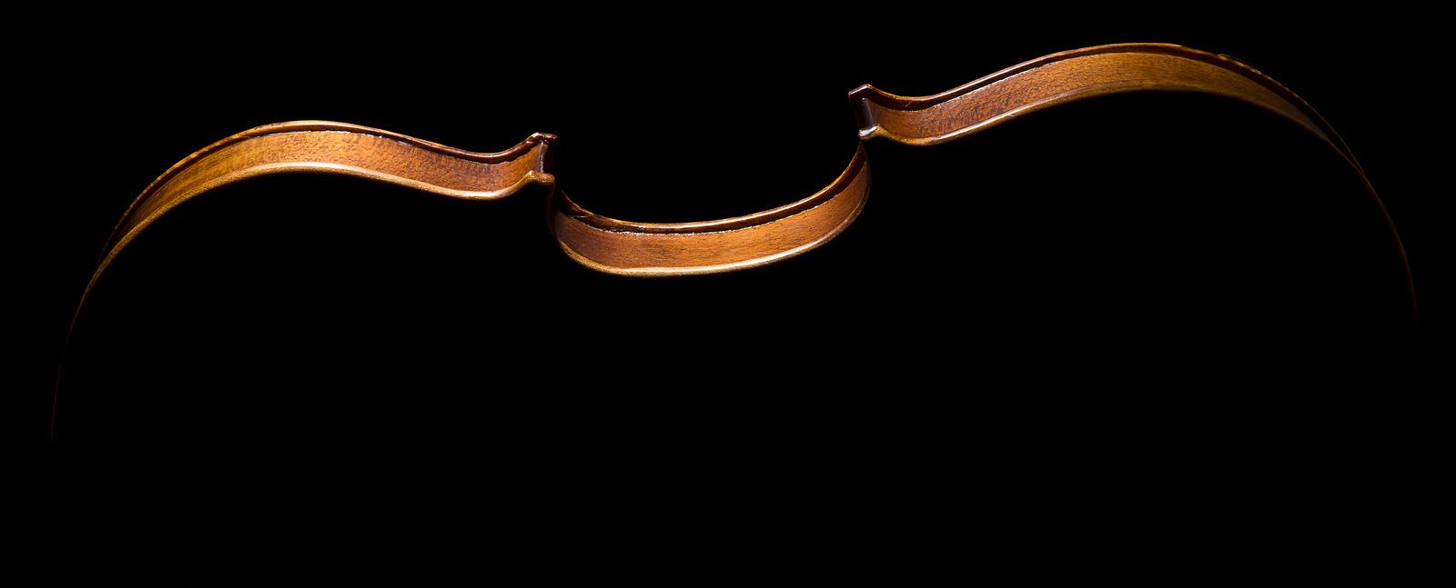 footer image of violin on its side